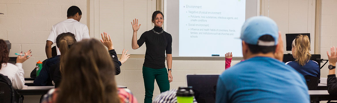 students being directed by a professor during class